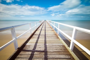 Long white pier and ocean