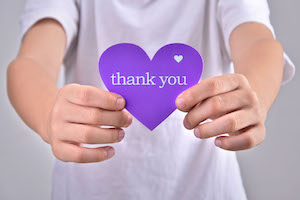 bigstock Children holding thank you heart purple